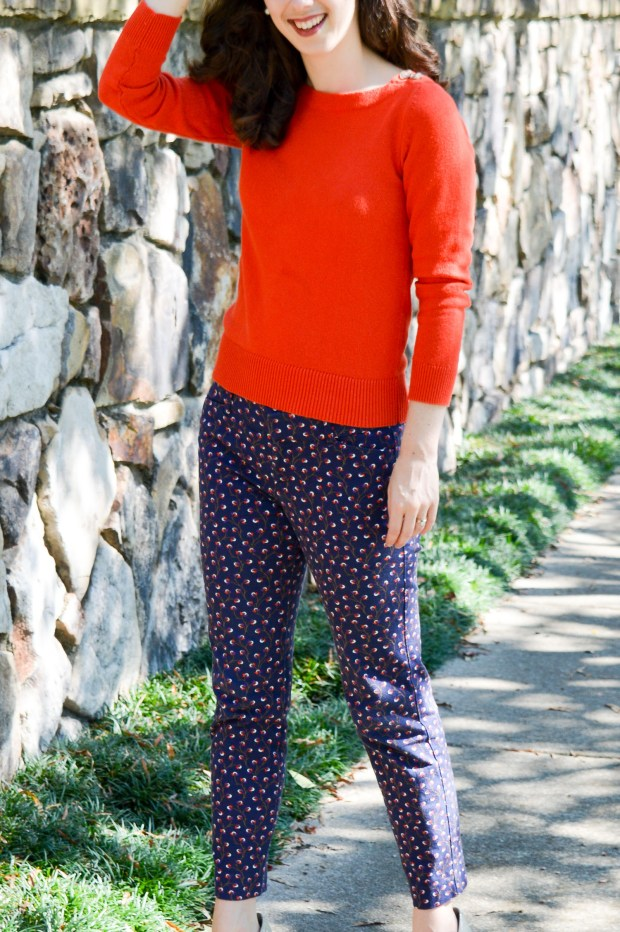 Orange sweater with tortoise shell buttons at the shoulders \\ cute details make the outfit!