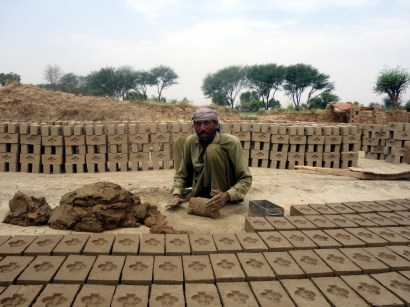 Worker in the brick kiln near Lahore, Pakistan