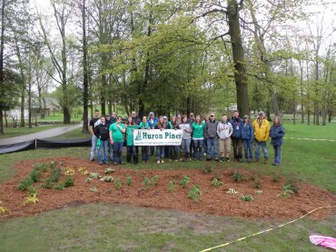 Volunteers gathered to protect Ogemaw Creek by installing rain gardens to filter pollution from runoff in Irons Park