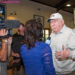 John Madden being interviewed by local news