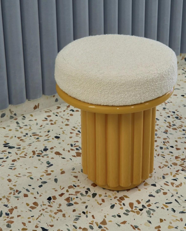 Terrazzo floor, round stool with padded seat