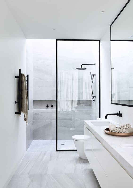 all-white bathroom wall decor