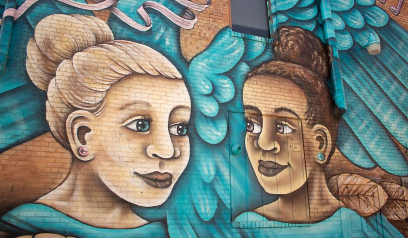 """The canvas for """"Swan Dance,"""" a mural by local artist Brady Scott, is on the Poetry in Motion Dance Productions building at Main Street and Fifth Avenue in Hutchinson."""