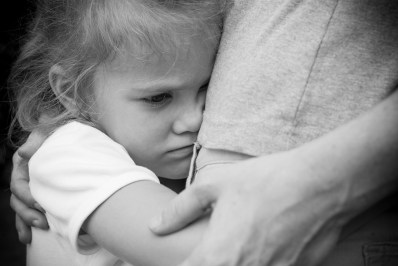 Child injury stressed hug adult