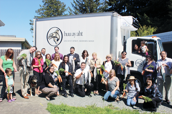 Port Alberni - 05-08-15 - Huu-ay-aht First Nations Elected Chief Councillor Jeff Cook hands over the key to the new refridgerator truck to Director of Community Services Kathy Waddell. The truck was purchased through the Generations Fund and will be used to distribute fresh food to Huu-ay-aht citizens. [Heather Thomson, Huu-ay-aht First Nations]