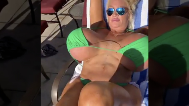 WATCH: Smash Or Pass? Woman With Massive Breasts Chillin At The Beach!