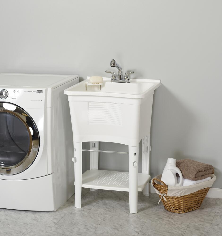 white freestanding laundry utility sink