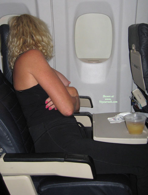 Naughty Blond With Curls Exposing Tits On An Airplane February 2008 Voyeur Web Hall Of Fame