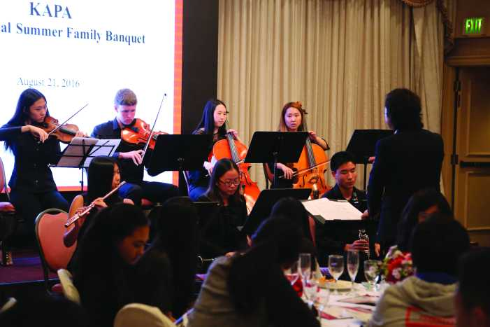 Upper school students perform at annual KAPA dinner, raise money for charities