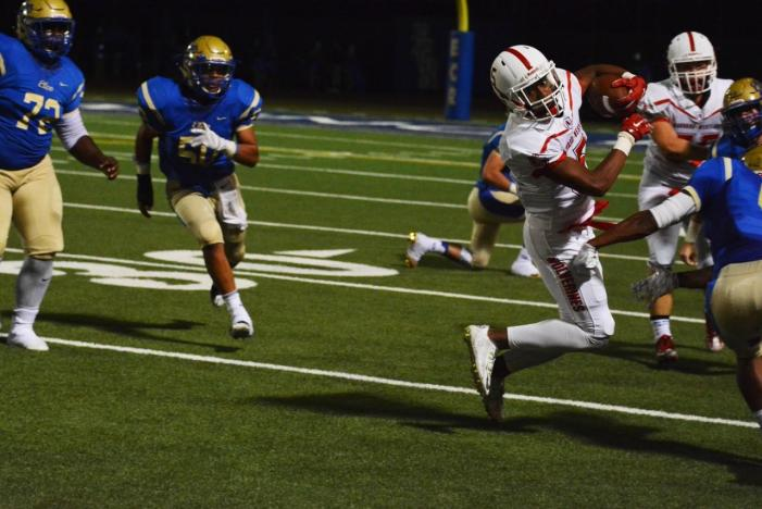 Wolverines' shaky start leads to 42-21 defeat