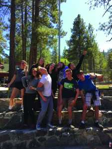 Seniors in Chamber Singers pose at the campsite during their retreat Sept. 16-17. Choir members attended the retreat at Camp Wrightwood to build friendships, strengthen relationships and bond as a choir. Attendees participated in a variety of different activities together over the course of the retreat. Printed with Permission of Cate Wolfen.
