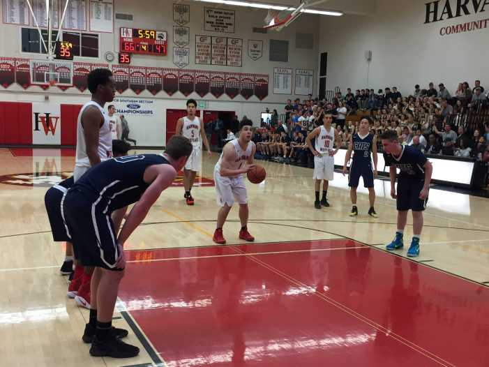 Boys' Basketball wins first playoff game