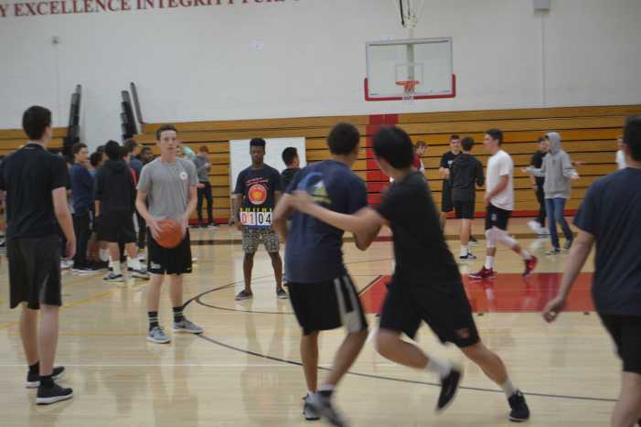 Students shoot hoops in March Madness tournament