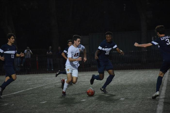 Boys' soccer defeated by crosstown rival