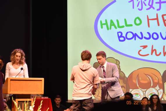 Foreign language teachers induct students into the National Foreign Language Society