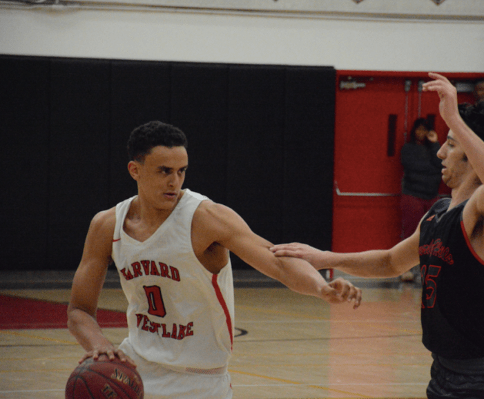 Boys' basketball wins first league game of the season