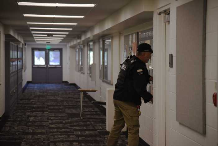 Security staff participates in lockdown drill with rest of school