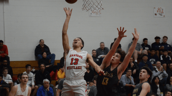 Boys' Basketball wins first game of its season and the Wolverine Invitational