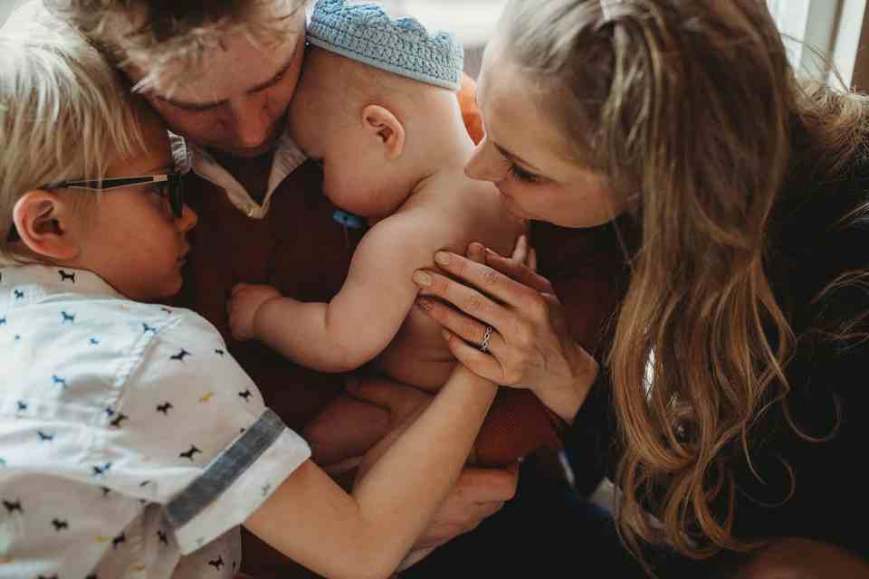 family holding baby Denver baby photographer