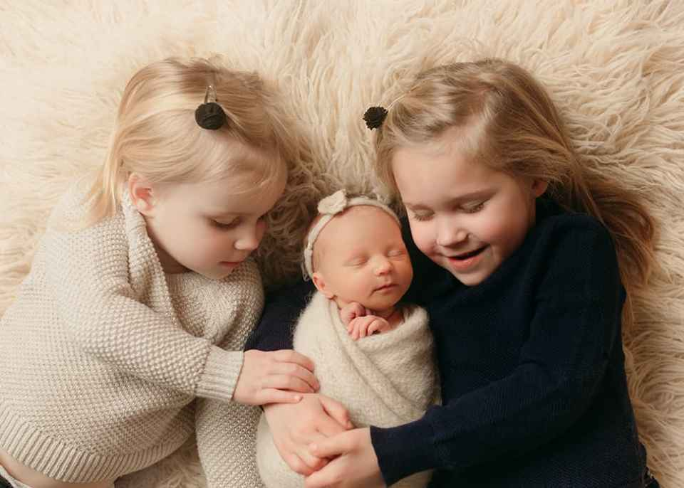 Sibling love Denver newborn photography