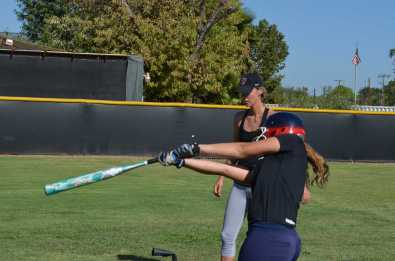 Griffith is seen at a softball field coaching and practicing. Credit: Keila McCabe '20