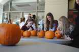 Students decorate pumpkins before the movie starts. Credit: Luke Schneider '20 / SPECTRUM
