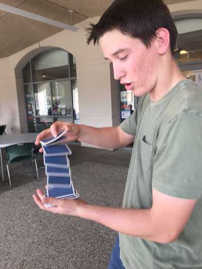 Skaggs shuffles a deck of cards in order to perform one of his tricks. Credit: Leila Dall'Olmo '20/SPECTRUM