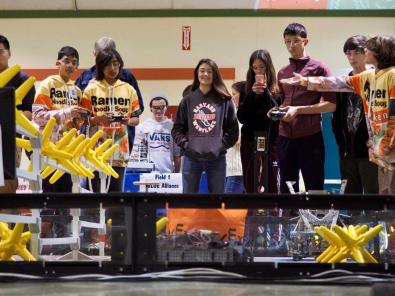 Coco Kaleel'20, Jenna Kronenberg'20, Justin Ansell'20, and Dean Reiter'20 watch their robot compete. Printed with permission of Coco Kaleel'20