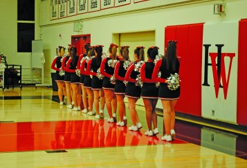 The Upper School cheerleaders line up and face the flag during the National Anthem prior to the game. Credit: Caitlin Chung '20/SPECTRUM