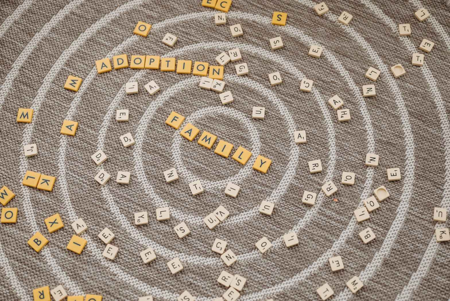scrabble tiles scattered on the brown carpet