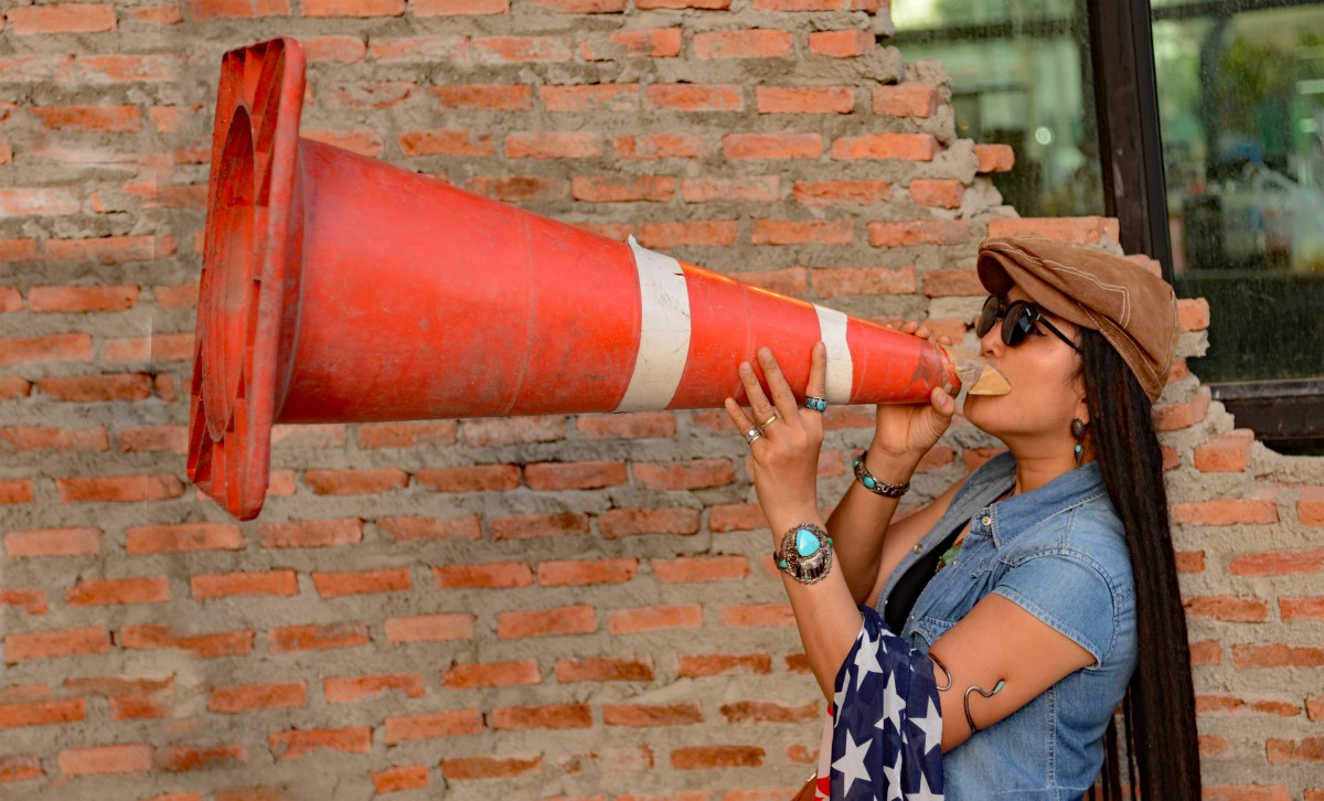 Woman yelling through cone