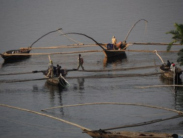 Night fishing boats on Lake Kivu, that use bright lights and suspended nets to fish for sardine-like sambaza