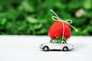 small toy car with red strawberries