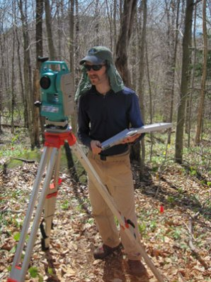 Cody running the total station.