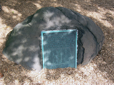 The plaque reads:  In Memory of the Courageous  Adventurers  Who Inspired and Directed by  Thomas Hooker Journeyed Though the  Wilderness from Newton (Cambridge)  in the Massachusetts Bay to  Suckiaug (Hartford) - October, 1635