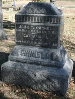 The grave marker of John Turley Gunnell (1796-1867) and his second wife Catherine Athelia McKenzie - Stouts Grove Cemetery, Danvers, McLean County, Illinois)