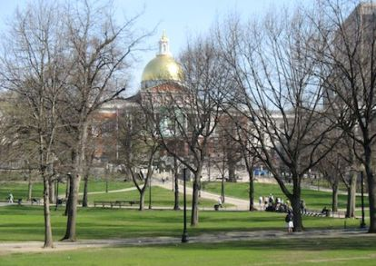 Across the Common, the huge golden dome of the Massachusetts State House gleams against the blue sky. Boston Common, along with the adjacent Public Garden, forms the heart of the older neighborhoods of the city collectively known as Boston Proper.