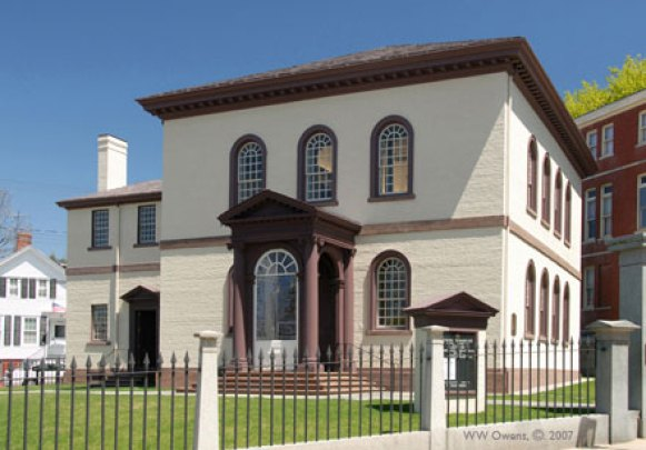 The Touro Synagogue in Newport, Rhode Island is the oldest synagogue building still standing in the United States, the oldest surviving Jewish synagogue building in North America and the only surviving synagogue building in the U.S. dating to the colonial era. It was built on land once owned by Nathaniel Dickens, which he sold Mordecai Campannall and Moses Packechoe for a burial-place for the Jews of Newport. in 1677. His property was located at what is today the corner of Bellvue Avenue and Touro Street.