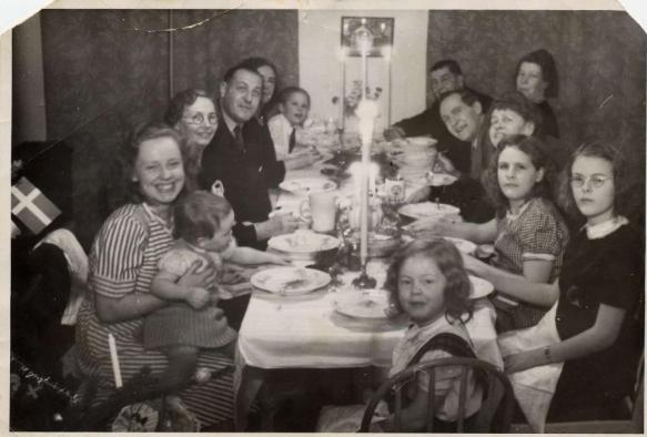 My paternal grandparents' family celebrating the coming of 1947 in Stockholm, Sweden. My father is on the laft at the far end of the table; my grandmother is on his right (mostly obscured); my grandfather is the man leaning forward on the right side of the table (3rd from the end); the two girls on the right side of the table in front are my Aunt Lizzie and Aunt Ingrid (wearing glasses).