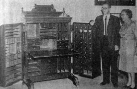 Elizabeth Hylbom and son, T. Martin Hylbom, present a desk to the Pioneers Museum (5 Sep 1962). The desk was once owned by Horace A.W. Tabor and was given to Mrs. Hylbom's grandfather, A.T. Gunnell, in payment of a legal fee (Colorado Springs Gazette Telegraph photo).