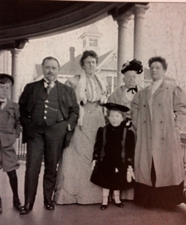Grace Watkins (far right) has her photograph taken with Paul & Florence Watkins, along with their children, Roderick & Florence, and Paul's mother, Julia (Morris) Watkins (taken on the porch of J.R. Watkins' home at 206 East Broadway in Winona).