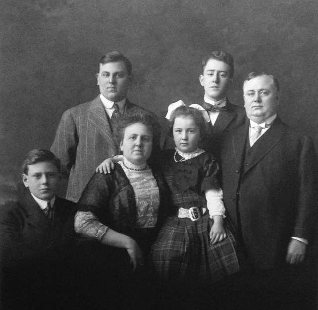 Paul Watkins family portrait (2 Jan 1911) - L to R: William, Florence (Henderson) Watkins, Florence (seated); Rod, Joe, Paul Watkins (standing)
