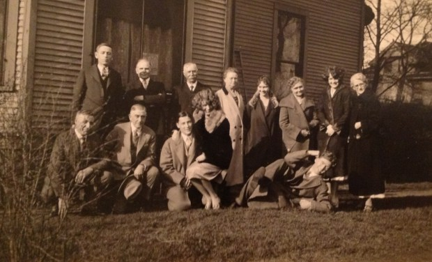 The Walholm extended family, Galesburg, Illinois- my grandfather (Roy Willard) lying on the ground in front, woman on far right is Ella, and next to her is Nell. Mildred sitting on man's lap.