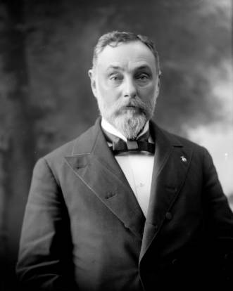 Studio portrait, head and shoulders, of Judge Allen Thomson Gunnell, Colorado attorney and politician; arrived in Lake City 1875; state legislator, 1878; County Judge in Leadville (1883-?); appointed to State Court of Appeals, 1889; arrived in Colorado Springs, 1893. (Denver Public Library Digital Collections, Rose & Hopkins, taken 1886-1901)