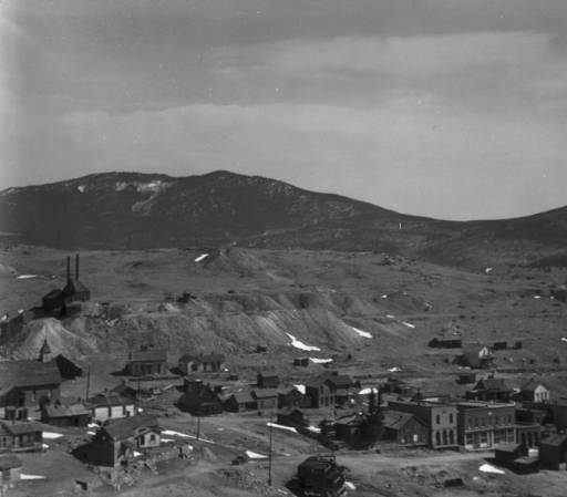 View over Nevadaville, Gilpin County, Colorado, includes wood dwellings, commercial buildings on Main Street, including the Redman's and Odd Fellow's Lodges, the Methodist Episcopal Church, and the Hubert Mine with tailings on Gunnell Hill. (Denver Public Library Digital Collections, 1930)