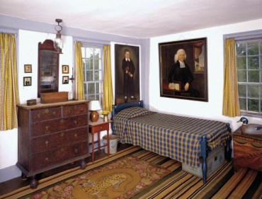 A child's room includes imposing family portraits and a nineteenth-century hooked rug with an unusual leopard design (Harvard Magazine, Jul-Aug 2014)