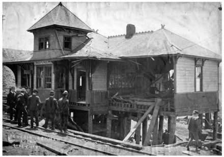 Men stand on the tracks surveying the damaged Independence Depot building after a bomb exploded, killing 13 non-union miners in Victor, Colorado, 6 Jun 1906 (photo by Schedin & Lehman, from Special Collections, Pikes Peak Library District)