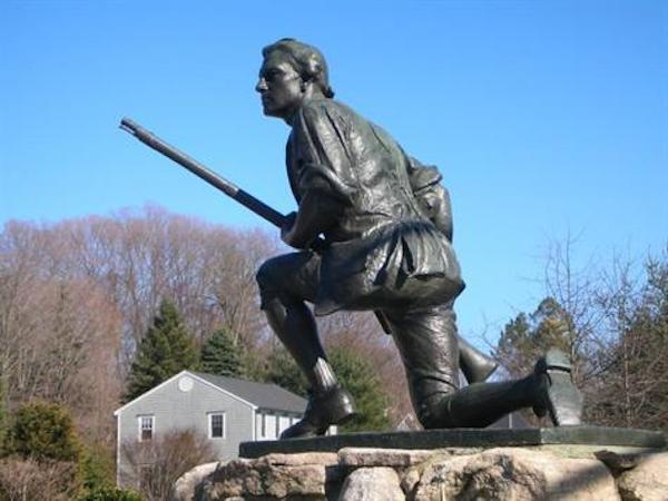 "The Westport (Connecticut) Minuteman monument kneels atop a traffic circle at the intersection of Compo Road South and Compo Beach Road. The monument depicts a musket-wielding Continental soldier waiting with his sleeves rolled up for the returning Redcoats. A plaque on the north side of the base reads ""To commemorate the heroism of the patriots who defended their country when the British invaded this state April 25th 1777. General David Wooster, Colonel Abraham Gould and more than one hundred Continentals fell in the engagements commencing at Danbury and closing on Compo Hill"". The monument was created by sculptor Harry Daniel Webster and was cast by Tiffany Studios in 1910."