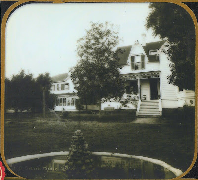 """The main residence at the Sierra Madre Villa was this Victorian home built in 1874 by noted artist William Cogswell and his son in law, William Porter Rhoades. Back in the late 1800's, """"the Villa"""" was world famous as a resort hotel. The hotel and the Cogswell/Rhoades house are long gone from Pasadena. In the mid-1940s, the Cogswell/Rhoades house was sold to the up-and-coming Walt Disney Studio in nearby Burbank. Disney moved the house up to Porterville where it was used on the set of """"So Dear to My Heart"""", a 1948 movie. They modified the old Victorian into a general store and the house appears in the movie as Grundy's Mercantile. After the film, Disney removed the decorative Victorian trim from the old Cogswell/Rhoades home and placed in storage for later use. Eventually, the trim quickly found a place on the turn of the century buildings that lined Disneyland's Main Street."""