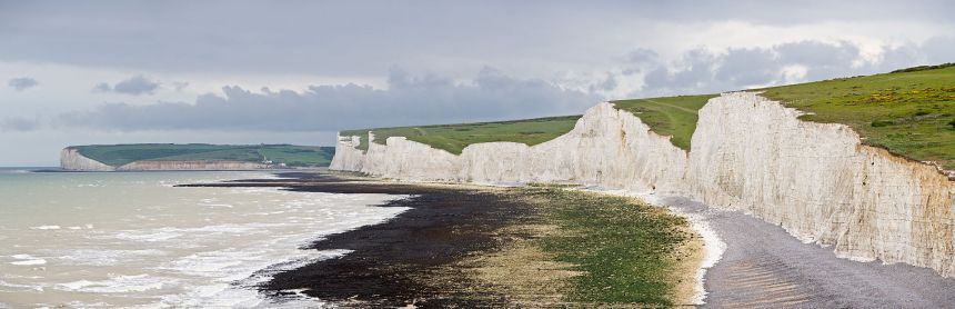 A panoramic view of all seven sisters from the Beachy Head cliffs near Birling Gap, looking back towards the River Cuckmere and Seaford Head in the background (photo credit: Diliff; taken 4 May 2009)